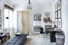 01 The home office space is done with vintage finds and designer furniture plus art