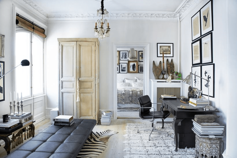 The home office space is done with vintage finds and designer furniture plus art