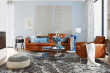 01 The living room is done with rust-colored leather furniture and blue accents