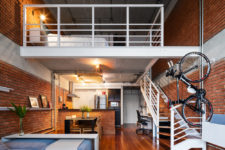 01 This industrial loft is a rented home, so when the designers were about to renovate it, they couldn't change the backdrop – walls, ceilings, floors