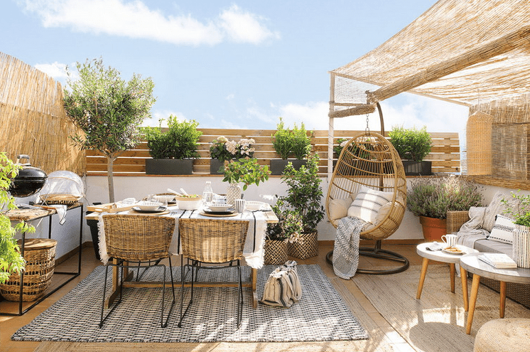 Summer-Ready Terrace With Much Greenery And Wicker
