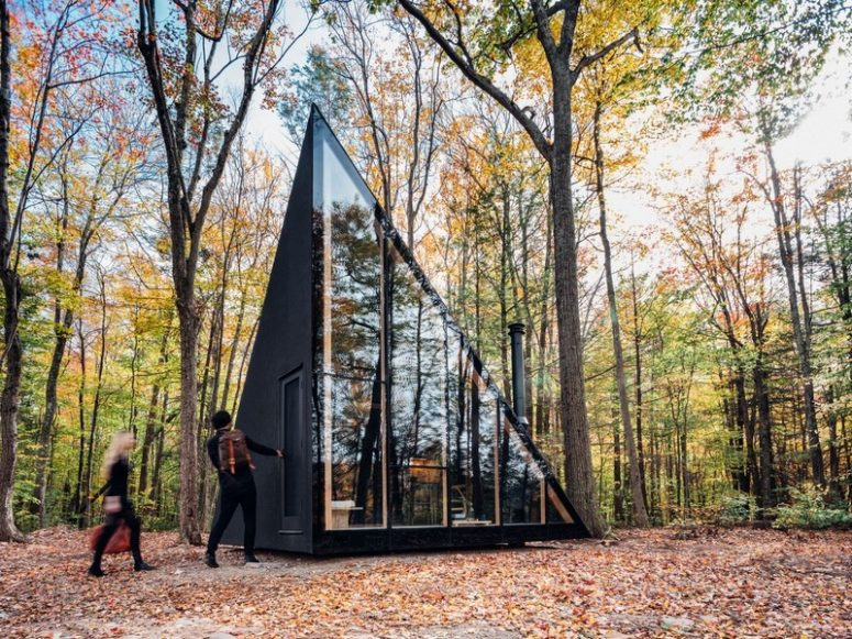 This tiny cabin in the woods features a unique crystal shape and is ideal for a weekend or a holiday