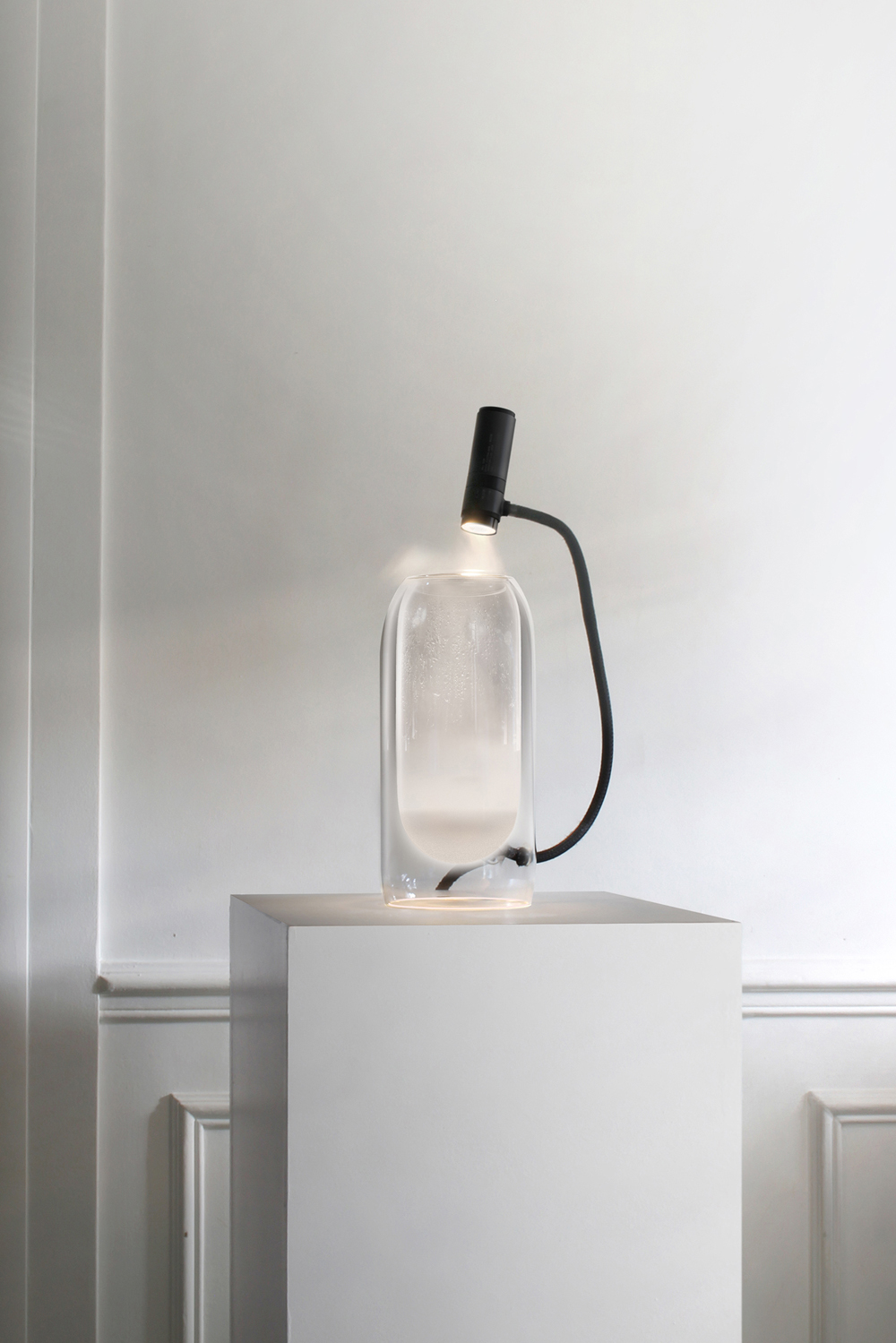 Brume fills your dwelling with soft light thanks to the mist, which is created inside it