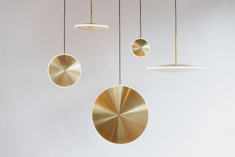 Each piece is made of spun brass and diffused acrylic and each lamp can be hung placing the disk vertically and horizontally