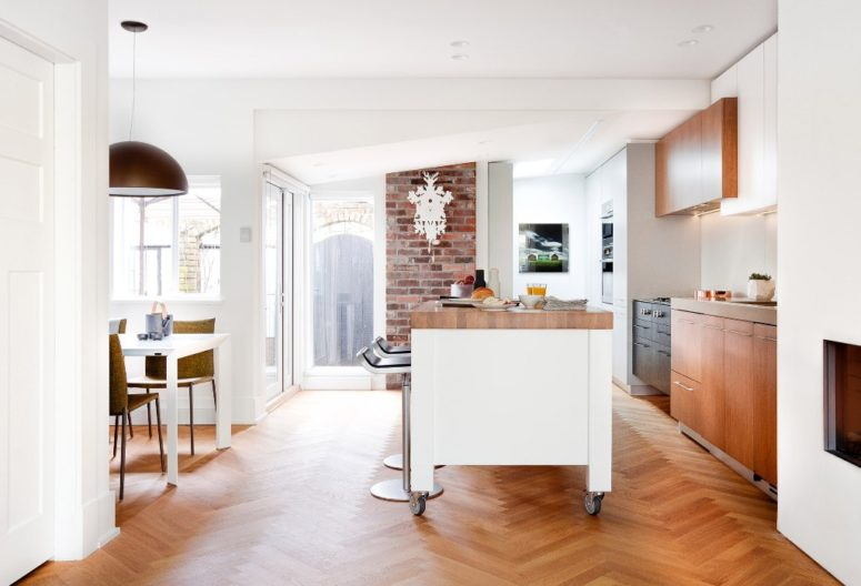 The kitchen is the main space of the house, whose owners are two chefs, and it takes the main part of the footage together with the dining space