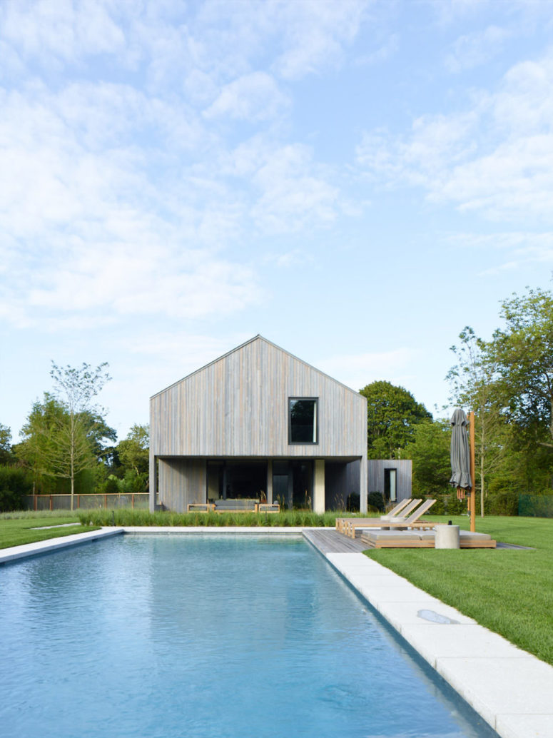 There's a large pool in the backyard plus a deck, and the house is clad with natural wood