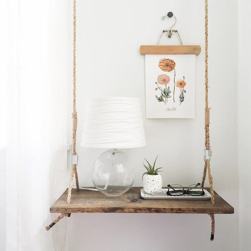 a cute swing style nightstand of wood and rope brings a cute summer feel to the space