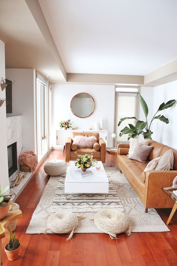 a neutral room with camel leather furniture and a tan colored ceiling for a chic look