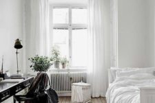 02 a serene and airy guest bedroom with lots of white and a vintage black desk plus chair to stand out