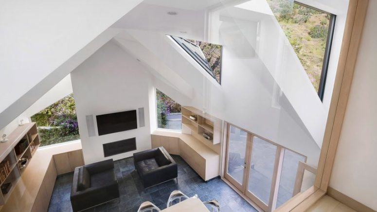 Inside it you can see one room with skylights, which is separated into two zones