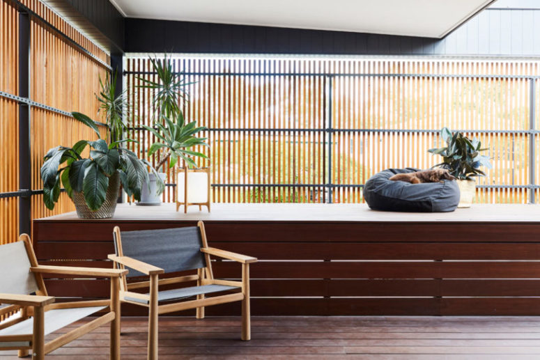 Potted plants and contemporary furniture make the deck welcoming