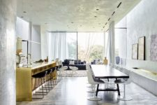 03 The dining and living rooms are united, there's much light thanks to glazed walls and gorgeous furniture