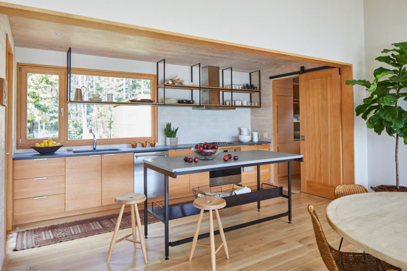 The kitchen is done with wooden cabinets and touches of blackened metal