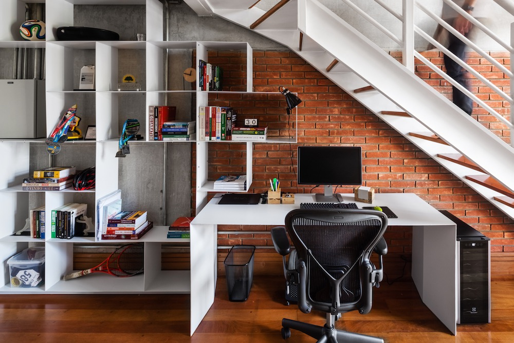 The under the stairs space features a desk with a chair, it's enough for working