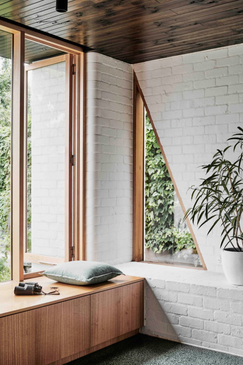 There's a large window and a couple of triangle cutouts for connecting the space to outdoors and fill it with natural light