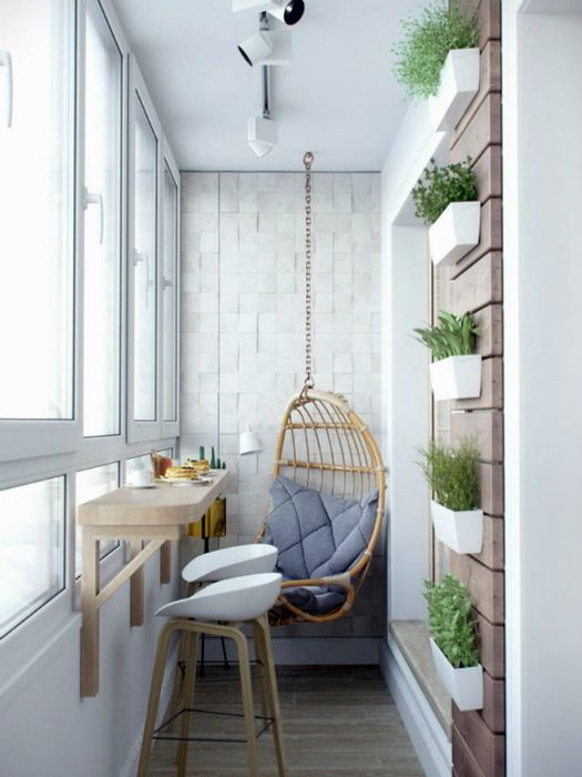 a balcony breakfast space with a wall-mounted table and tall stools plus a hanging chair