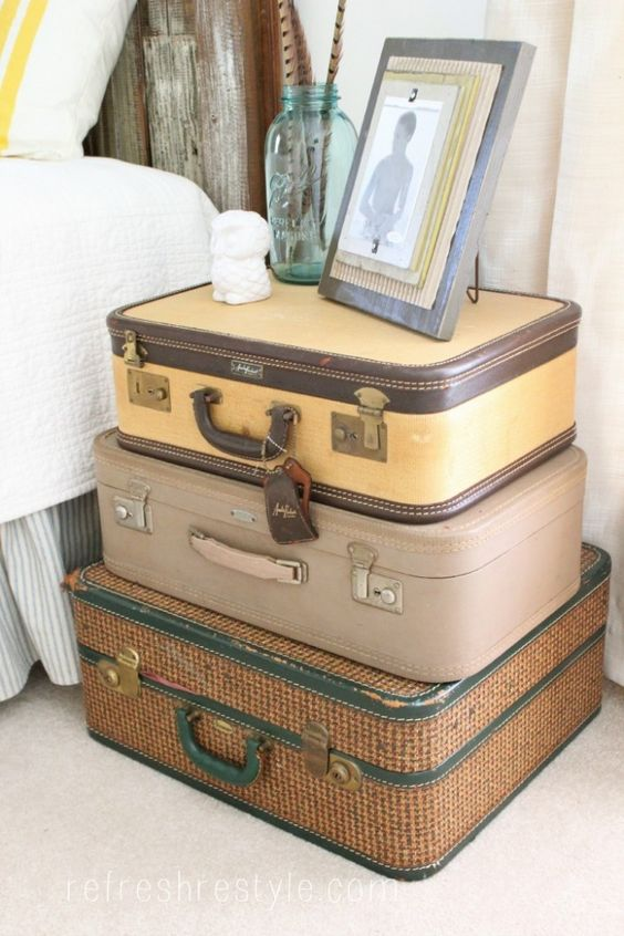 a cool stack of suitcases, they aren't vintage but look awesome anyway