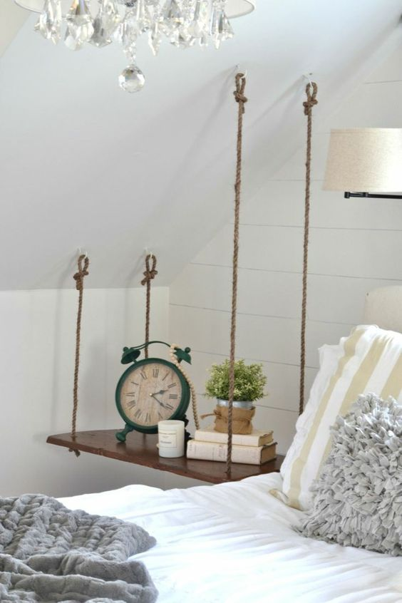a swing-style hanging nightstand is ideal for an attic bedroom and is very stable with 4 ropes