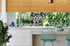 03 light-colored plywood and white cabinets plus stone counters look cool and modern and plants from outside refresh the kitchen