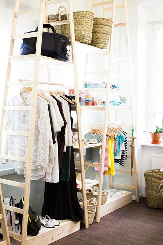 several tall ladders with shelves to create a comfy wardrobe for all kinds of clothes and accessories