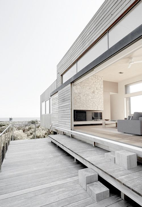 whitewashed on the outside and all-neutral inside, this beach home is opened to the ocean