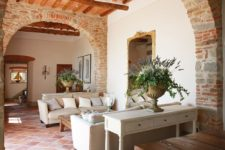 04 Original masonry and wooden beams on the ceiling create a vintage rustic ambience