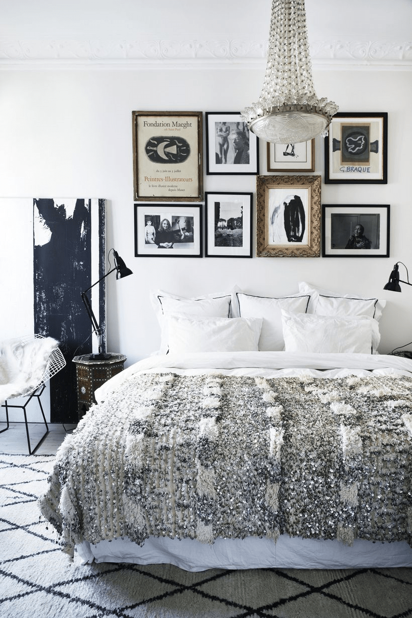 The bedroom is done with glam touches, art and Moroccan items