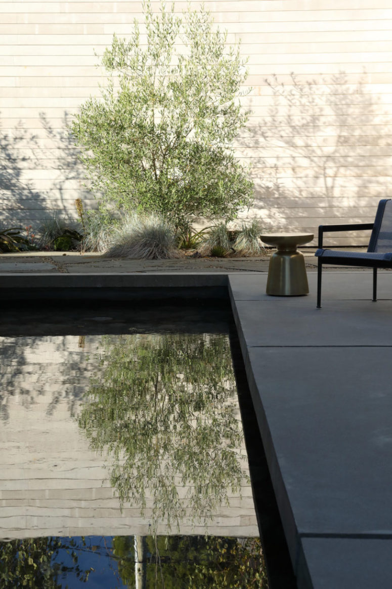 There are some plants here and there and stylish outdoor furniture