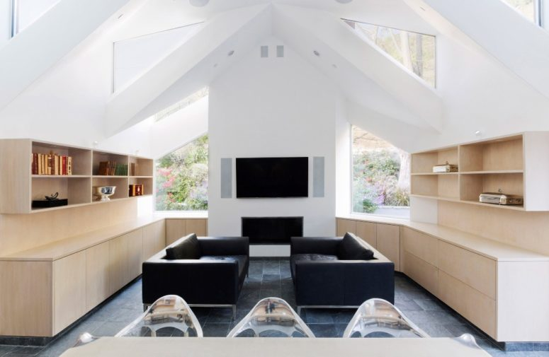 This is a sitting zone with two sofas, shelves and a built-in fireplace