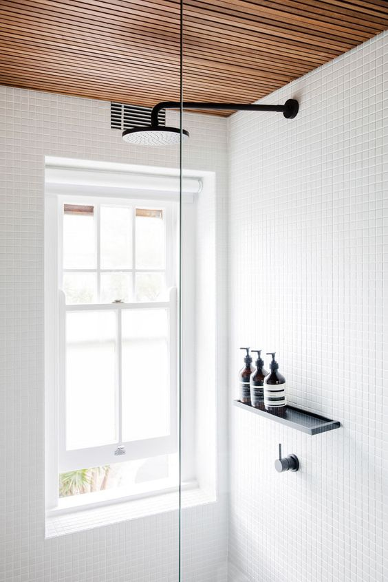 a pull-down blind provides privacy without blocking out too much light from the window