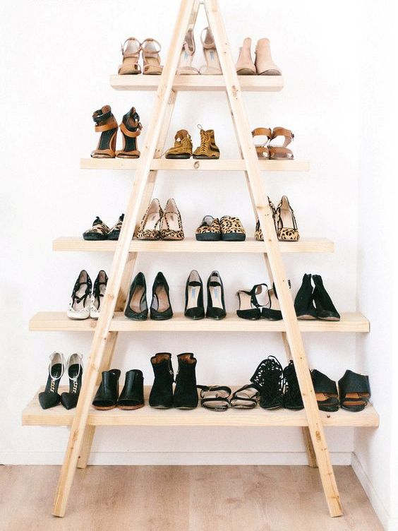 a stylish and comfy shoe shelf made of ladders and shelves will accomodate all your shoes and booties