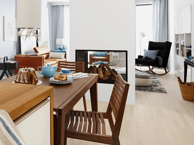 The built-in fireplace divides the living and dining rooms