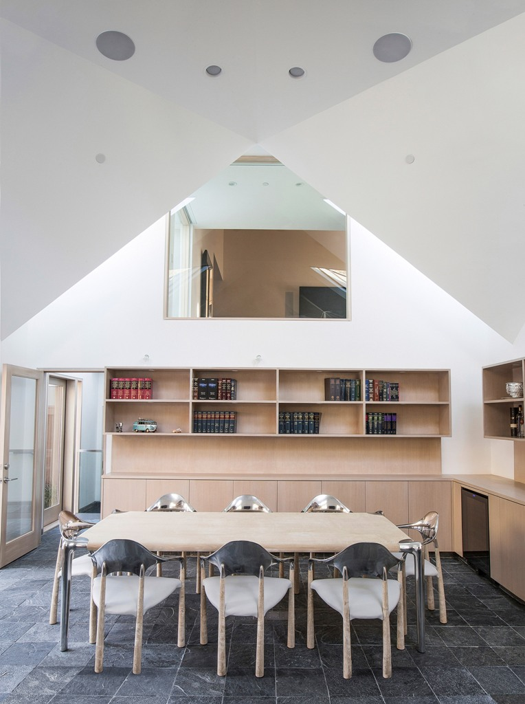 This is a conference zone with bookshelves and a table that can accommodate up to 8 people