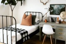 05 a woodland-inspired guest bedroom with a desk by the bed to use it as a nightstand too