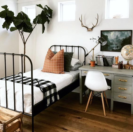a woodland-inspired guest bedroom with a desk by the bed to use it as a nightstand too