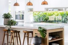 05 continue the outdoor greenery decor with indoor plants to tie the kitchen to outdoors
