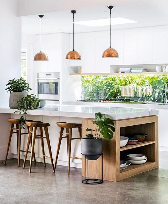continue the outdoor greenery decor with indoor plants to tie the kitchen to outdoors
