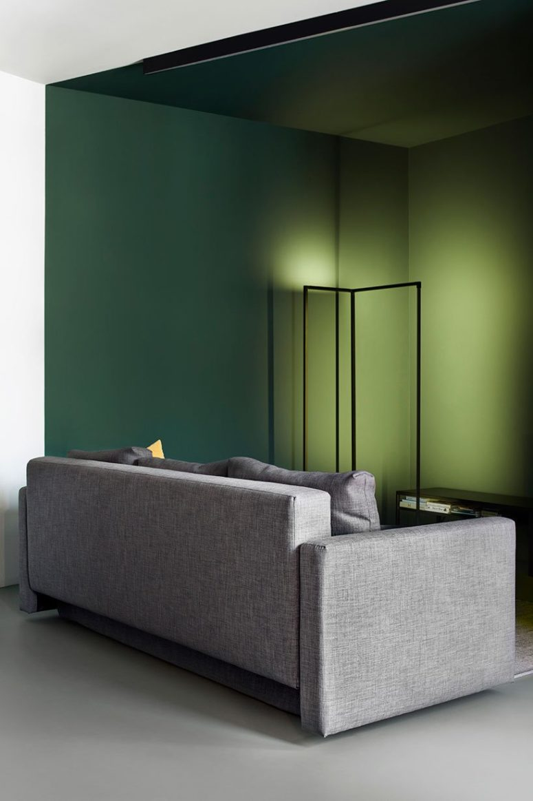 In the living room, the 'color pocket' separates the resting zone and the passage