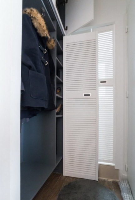 The closet is tiny and can be reached through the bedroom