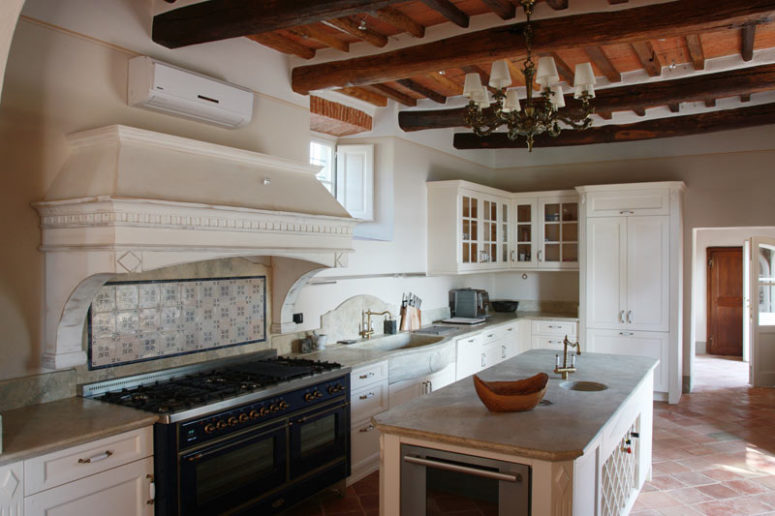 The kitchen is large, with white vintage cabinets and a kitchen island