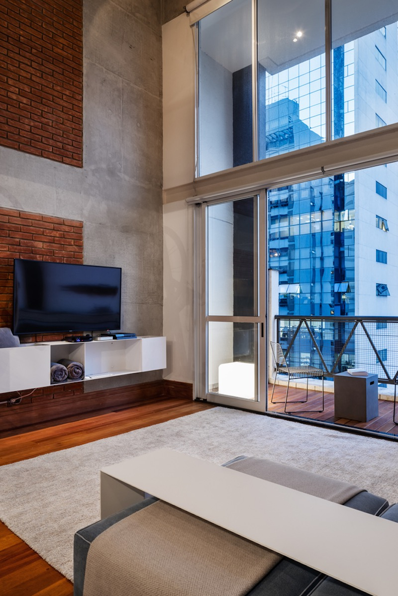 The living room features access to a balcony