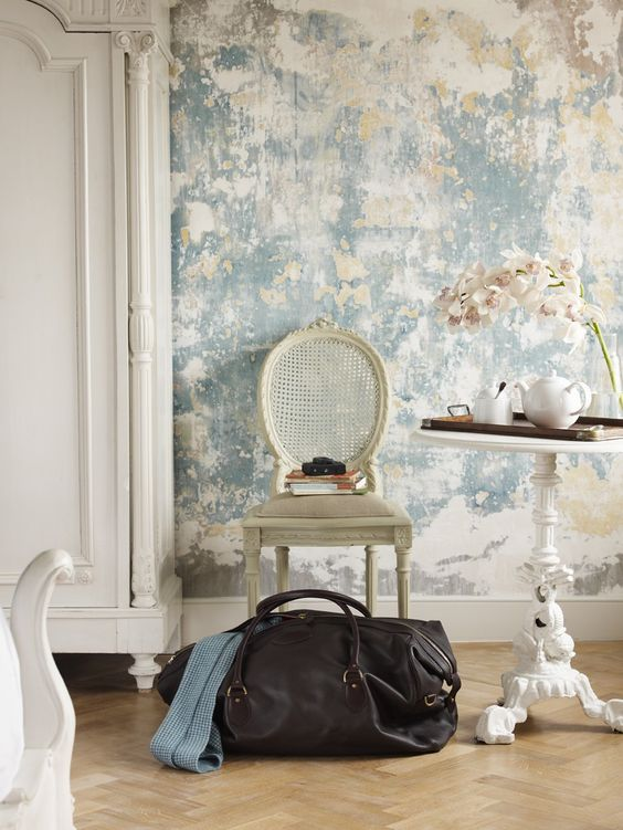 a grey shabby plaster wall plus vintage furniture create a dreamy shabby chic space