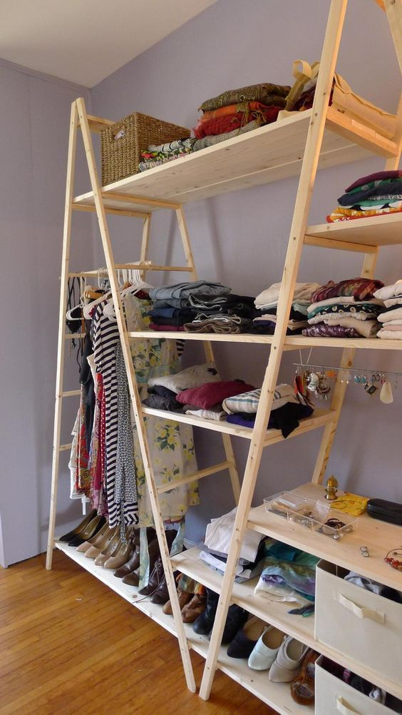 a large and comfy wardrobe made of several ladders and shelves added to store everything you can