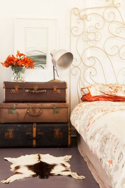 a stack of vintage suitcases is great for storage and will bring a vintage feel to the space