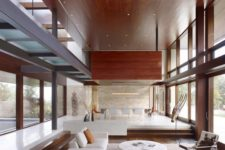 06 divide the spaces visually and in an airy way making a sunken living room and a usual dining one