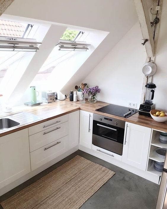 kitchen cabinets built-in under the attic skylights to fill the cooking space with light
