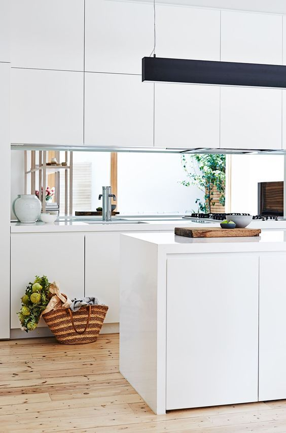 a contemporary white kitchen with sleek cabinets allows seeing the inner courtyard