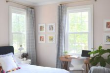 07 a cozy and wlecoming guest bedroom features a small desk by the window and a modern chair