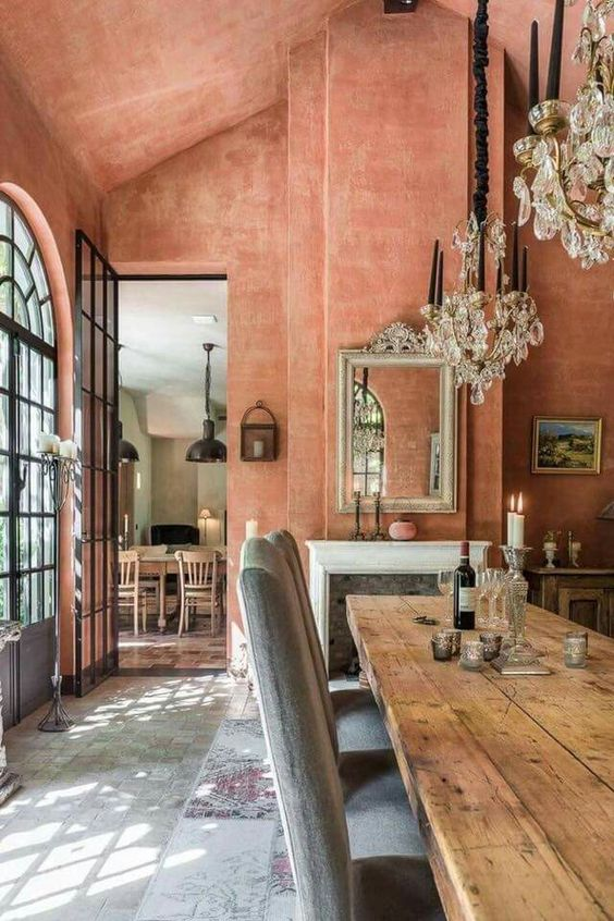 coral plaster walls and ceiling make the space bright and vivacious though not too colorful