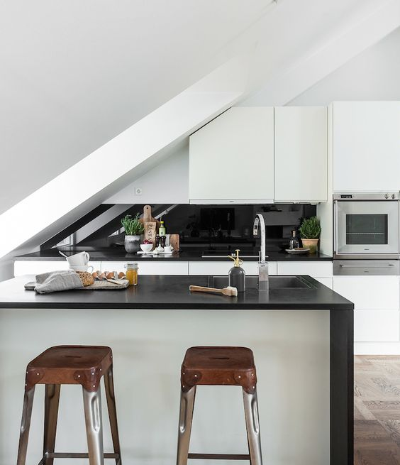 don't be afraid to hang cabinets in an attic kitchen, just cut them off where necessary